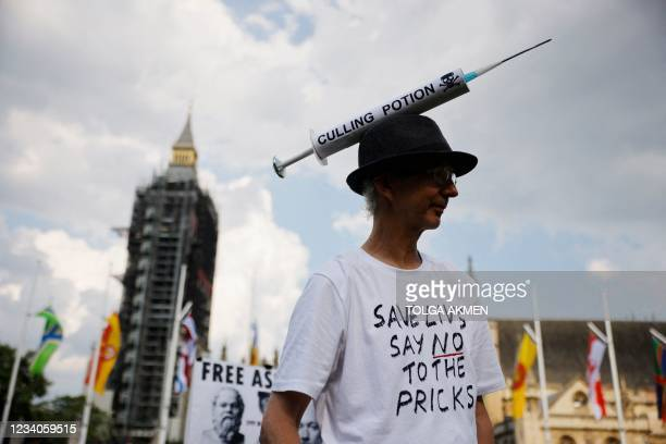 Anti-vaccination protesters against the coronavirus vaccine gather in Parliament Square outside the Houses of Parliament in central London on July...
