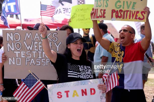 Anti-vaccination protesters take part in a rally against Covid-19 vaccine mandates, in Santa Monica, California, on August 29, 2021.
