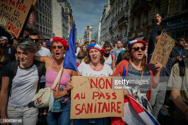 Anti-Vaccine demonstrators chant through the streets of Paris in protest to new restrictions announced by French President Emmanuel Macron on Monday...