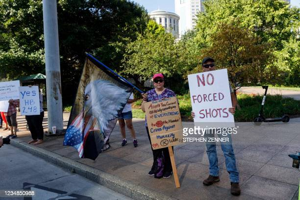 Anti-vaccine mandate protesters demonstrate, on August 24 outside of the Ohio Statehouse in Columbus, to support the Vaccine Choice and...