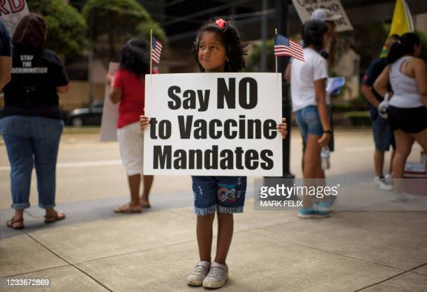 Anti-vaccine rally protesters hold signs outside of Houston Methodist Hospital in Houston, Texas, on June 26, 2021. - A spokesperson for Houston...