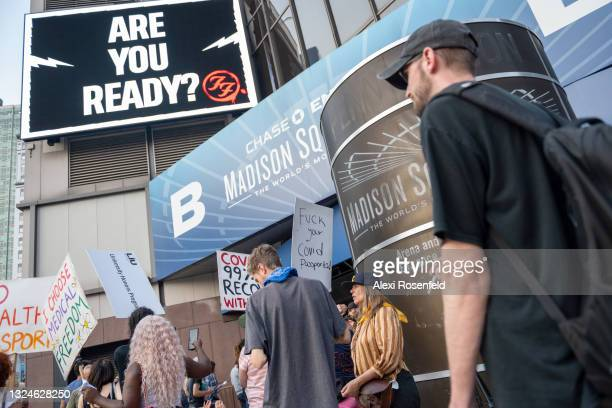 Anti-Vaxxers protest outside the Foo Fighters concert at Madison Square Garden on June 20, 2021 in New York City. The Foo Fighters concert is the...