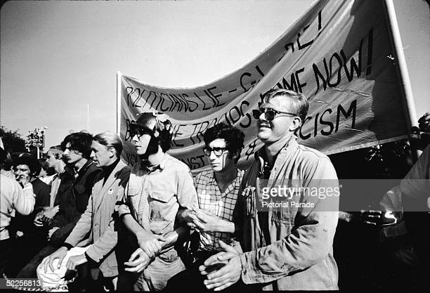 AntiVietnam War prostestors link arms as they march outside the 1968 Democratic National Convention Chicago Illinois August 1968