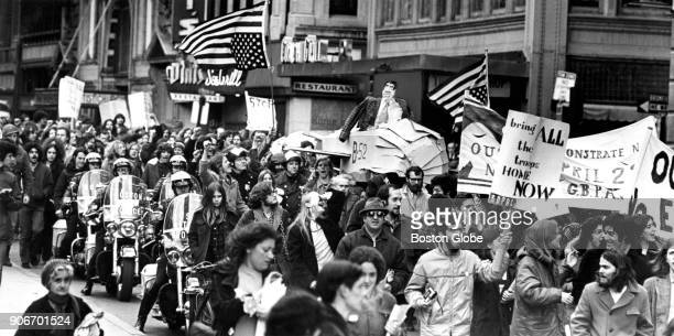 AntiVietnam War protesters carry upsidedown American flags and an effigy of US President Richard Nixon while marching along Tremont Street in Boston...
