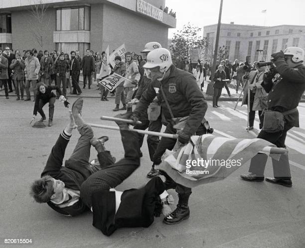 AntiVietnam war protesters knocked down by DC police circa 1970