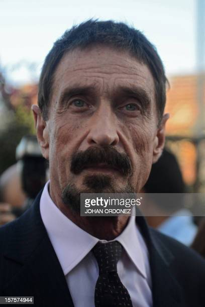 US antivirus software pioneer John McAfee looks on in front of the Supreme Court in Guatemala City on December 04 2012 McAfee wanted for questioning...