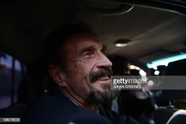 US antivirus software pioneer John McAfee smiles as he arrives at the Aurora international airport in Guatemala City on December 12 2012 McAfee...