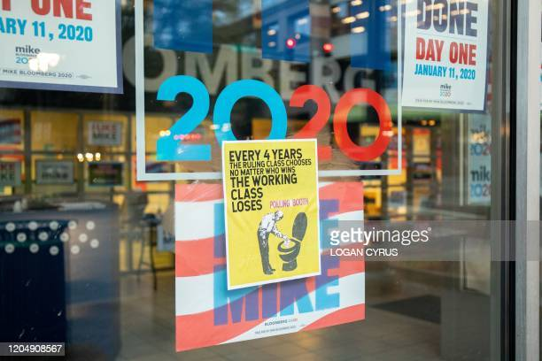 Anti-voting propaganda is pasted on the windows of the Michael Bloomberg campaign office in uptown Charlotte during the North Carolina primary on...