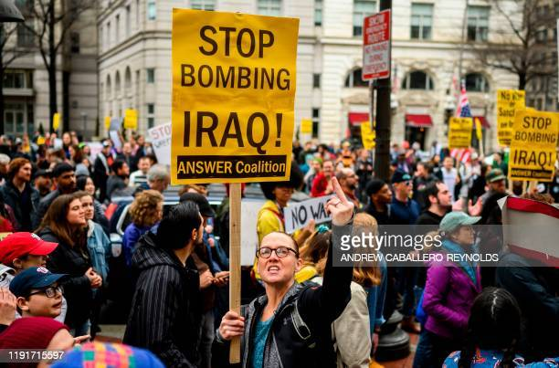 TOPSHOT Antiwar activist demonstrate outside the Trump International Hotel in Washington DC on January 4 2020 Demonstrators are protesting the US...