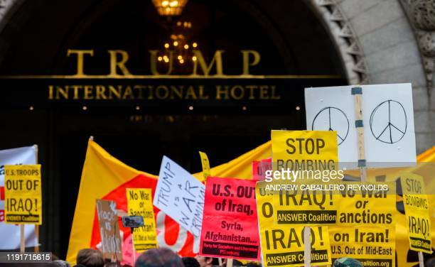 Antiwar activist demonstrate outside the Trump International Hotel in Washington DC on January 4 2020 Demonstrators are protesting the US drone...