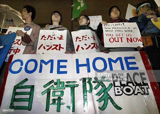 Antiwar activists hold a banner as they stage an demonstration in front of Prime Minister's official residence in Tokyo 13 April 2004 Some 800...