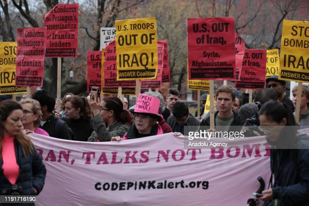 Anti-war activists hold banners during a protest organised by 'CodePink' in front of the White House following the killing of Iranian Revolutionary...