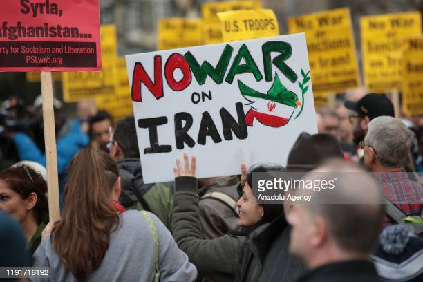 Antiwar activists hold banners during a protest organised by 'CodePink' in front of the White House following the killing of Iranian Revolutionary...