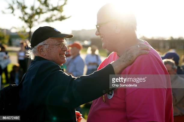 Antiwar activists Paul Lauter and Bruce Beyer embrace during a vigil commeorating the 50th anniversary of the 1967 March on the Pentagon outside the...