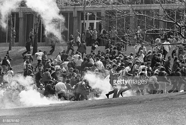 Anti-war demonstrators at Kent State University run as National Guardsmen fire tear gas and bullets into the crowd.