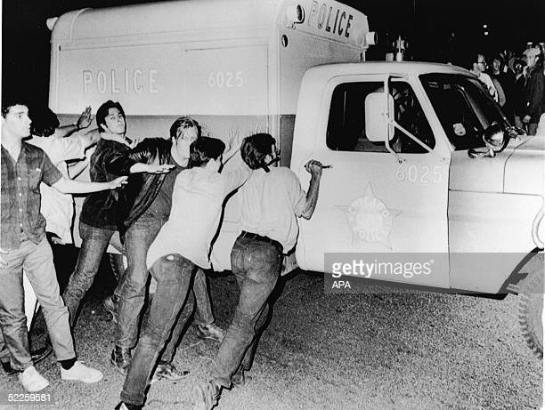 Antiwar demonstrators attempt to push over a Chicago Police Department vehicle on Michigan Avenue during the antiVietnam War protests surrounding the...