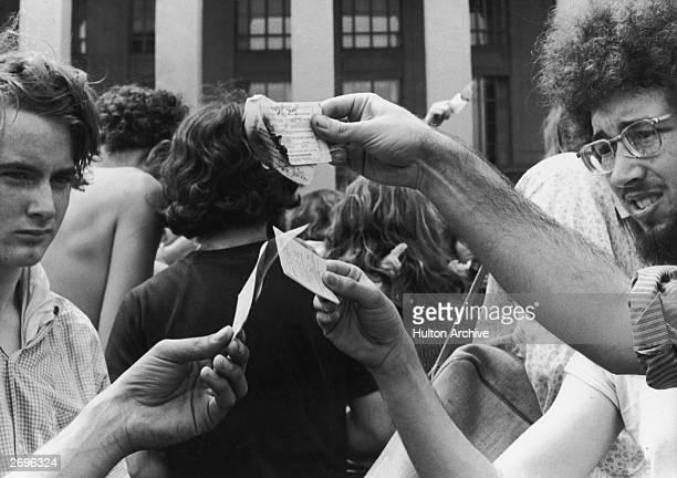 Antiwar demonstrators burn their draft cards on the steps of the Pentagon during the Vietnam War Washington DC