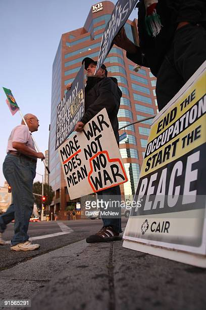 Antiwar demonstrators call for a troop pullout in Afghanistan as they rally near the Federal Building eight years after the start of the war on...