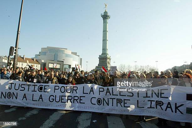 Antiwar demonstrators hold a banner in the Bastille Square March 15 2003 in Paris France Thousands of demonstrators lined the streets of Paris to...