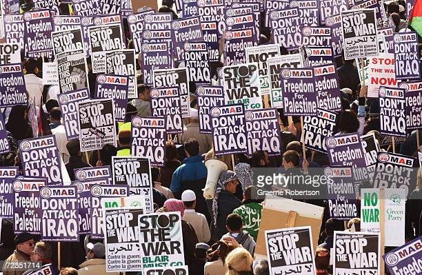 Antiwar demonstrators hold banners while marching March 21 2003 in London England The war against Iraq continues with air assaults on Iraq