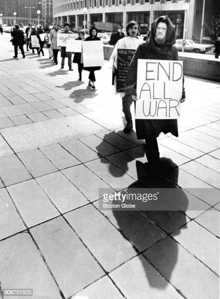 Antiwar demonstrators march outside the John F Kennedy Federal Building in Boston on March 19 1970
