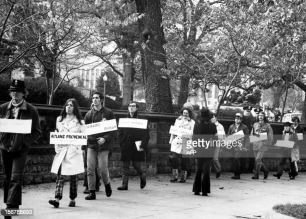 Antiwar demonstrators march outside the White House on November 15 1969 in Washington DC for the second Moratorium Day to protest against the...