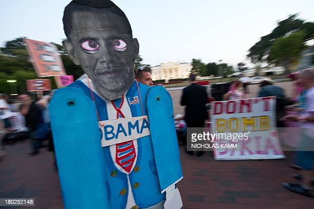 Antiwar demonstrators protest against US intervention in Syria in front of the White House in Washington on September 10 2013 before US President...