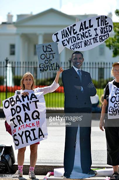 Antiwar demonstrators protest in front of the White House in Washington DC on September 2 against a possible US attack on Syria in response to...