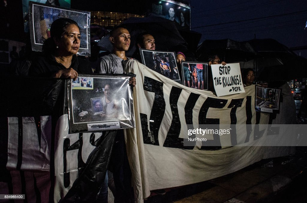 Anti-war on drugs groups hold pictures of victims of drug related extra-judicial killings on a protest in Manila, Philippines, on 18 August 2017. More than 80 people were killed in the last four days in President Rodrigo Duterte's war on drugs.