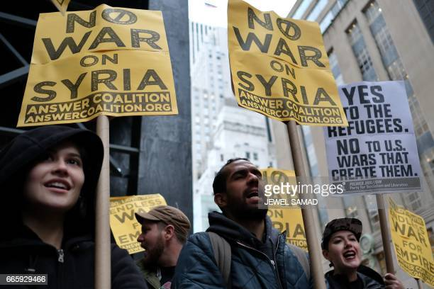 Antiwar protesters shout slogans against US President Donald Trump during a demonstration in front of the Trump Tower in New York on April 7 to...