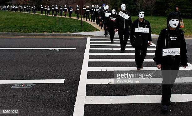 Antiwar protesters take part in a demonstration titled 'March of the Dead' near Arlington Cemetery's Women's Memorial March 19 2008 in Arlington...