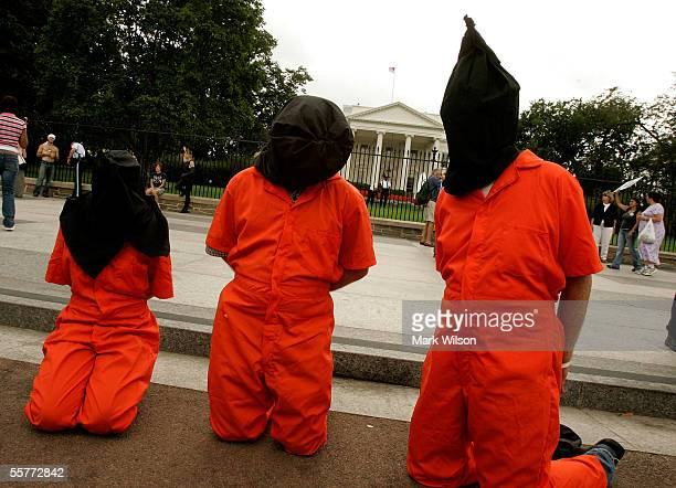 AntiWar protesters wear Abu Ghraib prison garb during a protest in front of the White House September 26 2005 in Washington DC AntiWar protester...