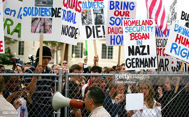 Antiwar protestors demonstrate outside the courthouse at the Michael Jackson child molestation trial at the Santa Barbara County Courthouse June 3...