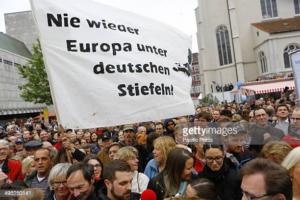 REGENSBURG BAVARIA GERMANY Antiwar protestors hold up a banner that reads 'Europe shall never be under German boots again' and shout antiwar and...