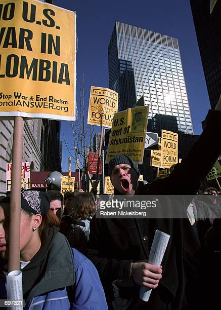 AntiWorld Economic Forum protesters march a few blocks from the Waldorf Astoria Hotel February 2 2002 where WEF meetings are taking place in New York...