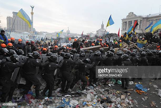 AntiYanukovych protesters clash with antiriot police on Independence Square in Kiev on December 11 2013 Ukrainian security forces pulled out of the...
