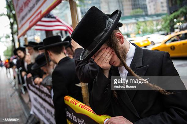 AntiZionist Orthodox Jews protest outside US Sen Chuck Schumer's Manhattan offices over his decision not to support President Obama's Iranian nuclear...