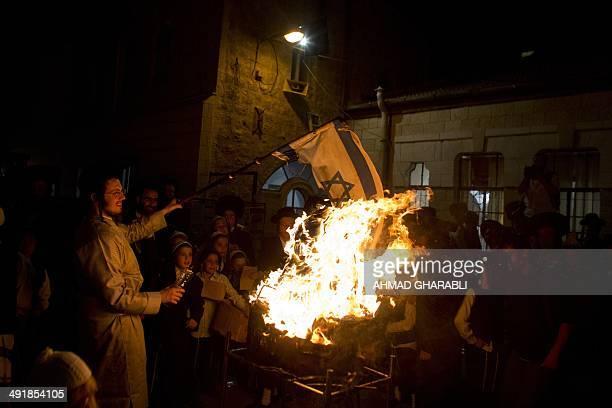 AntiZionist Ultra Orthodox men members of the Neturei Karta group burn the Israeli flag during the Lag Baomer celebration in the Mea Shearim...