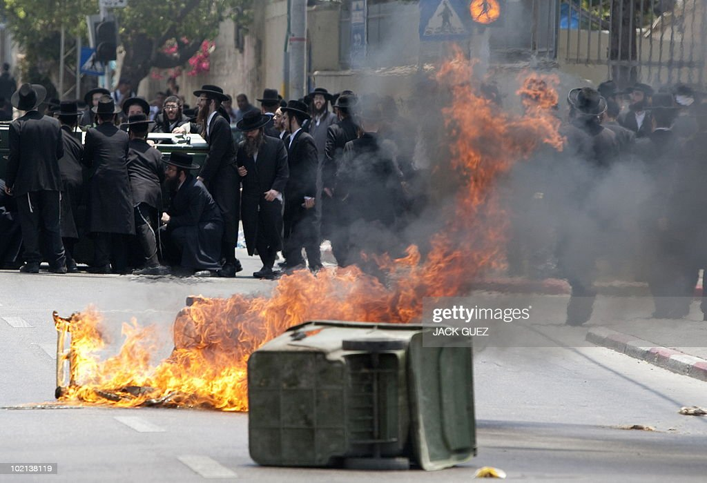 Anti-Zionist, Ultra-Orthodox Jewish men protest against the removal of ancient tombs in Jaffa, just south of Tel Aviv, on June 16, 2010 where construction is due to take place at the site where religious men say Jewish graves are located.