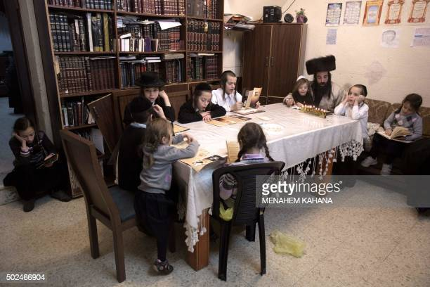 SMITH AntiZionist UltraOrthodox Jewish Yoeilish Krois who is against the military service lights candles during the Jewish holiday of Hanukkah with...