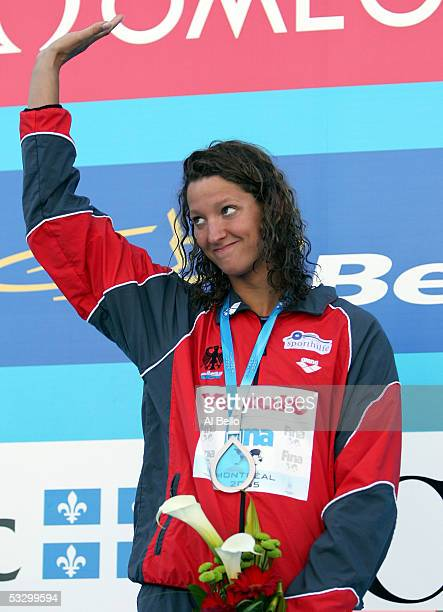 Antje Buschschulte of Germany waves to the crowd after receiving the bronze medal in the 50 meter Backstroke final during the XI FINA World...