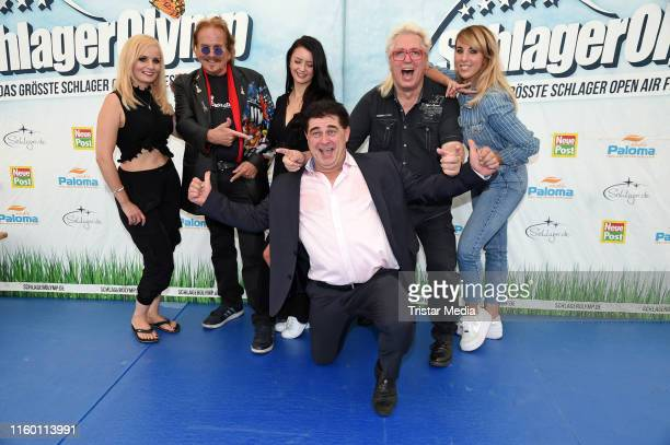 Antje Klann, Frank Zander, Sotiria , Olaf Schenk and Hans Orendt of the duo 'Olaf und Hans' and Annemarie Eilfeld attend the SchlagerOlymp press...