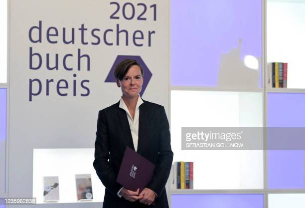 """Antje Ravik Strubel, author of the novel """"Blaue Frau"""" poses on stage after being awarded with the German Book Prize 2021 in Frankfurt am Main,..."""