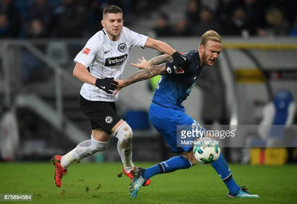 Antje Rebic of Frankfurt and Kevin Vogt of Hoffenheim compete for the ball during the Bundesliga match between TSG 1899 Hoffenheim and Eintracht...