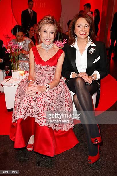 AntjeKatrin Kuehnemann and Uschi Daemmrich von Luttitz attend the Mon Cheri Barbara Tag 2014 at Haus der Kunst on December 4 2014 in Munich Germany