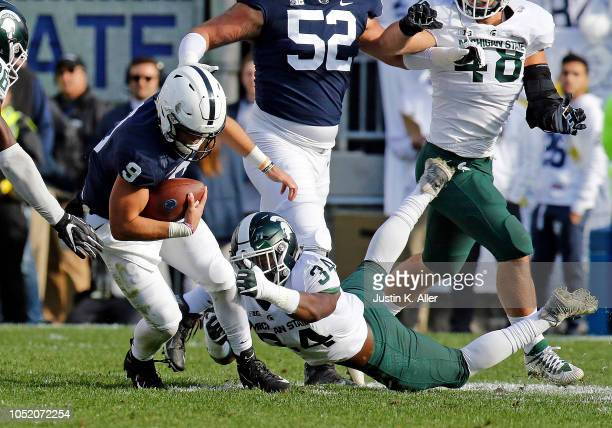 Antjuan Simmons of the Michigan State Spartans tackles Trace McSorley of the Penn State Nittany Lions on October 13 2018 at Beaver Stadium in State...