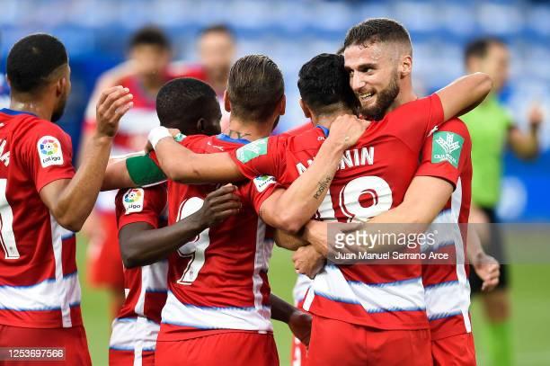 Antoñin Cortes of Granada CF celebrates with his team mate Domingos Duarte of Granada CF after scoring his team's first goalduring the Liga match...