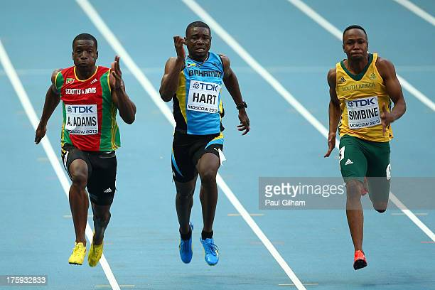 Antoine Adams of Saint Kitts and Nevis Shavez Hart of Bahamas and Akani Simbine of South Africa compete in the Men's 100 metres heats during Day One...