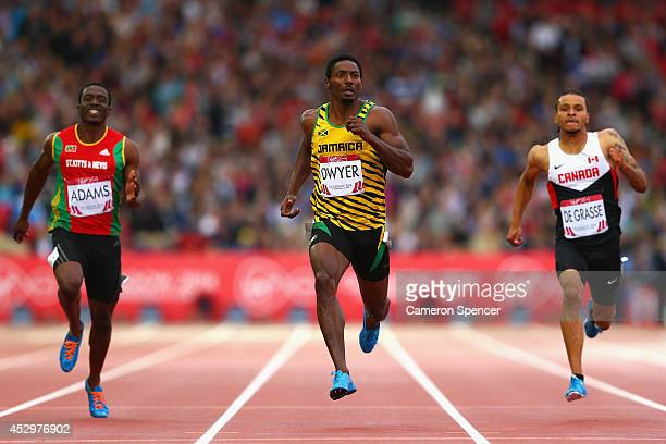 Antoine Adams of St Kitts and Nevis Rasheed Dwyer of Jamaica and Andre de Grasse of Canada compete in the Men's 200 metres semifinal at Hampden Park...