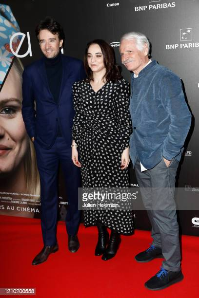 Antoine Arnault Anastasia Mikova and Yann Arthus Bertrand attend the Woman Premiere At UGC Normandie on March 03 2020 in Paris France